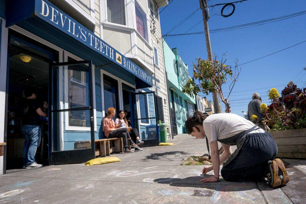 Clara Davis, draws with chalk on her break at Devil's Teeth Baking Company on 3876 Noriega Street, in San Francisco on Friday, March 31, 2017 (Sarahbeth Maney/Xpress).