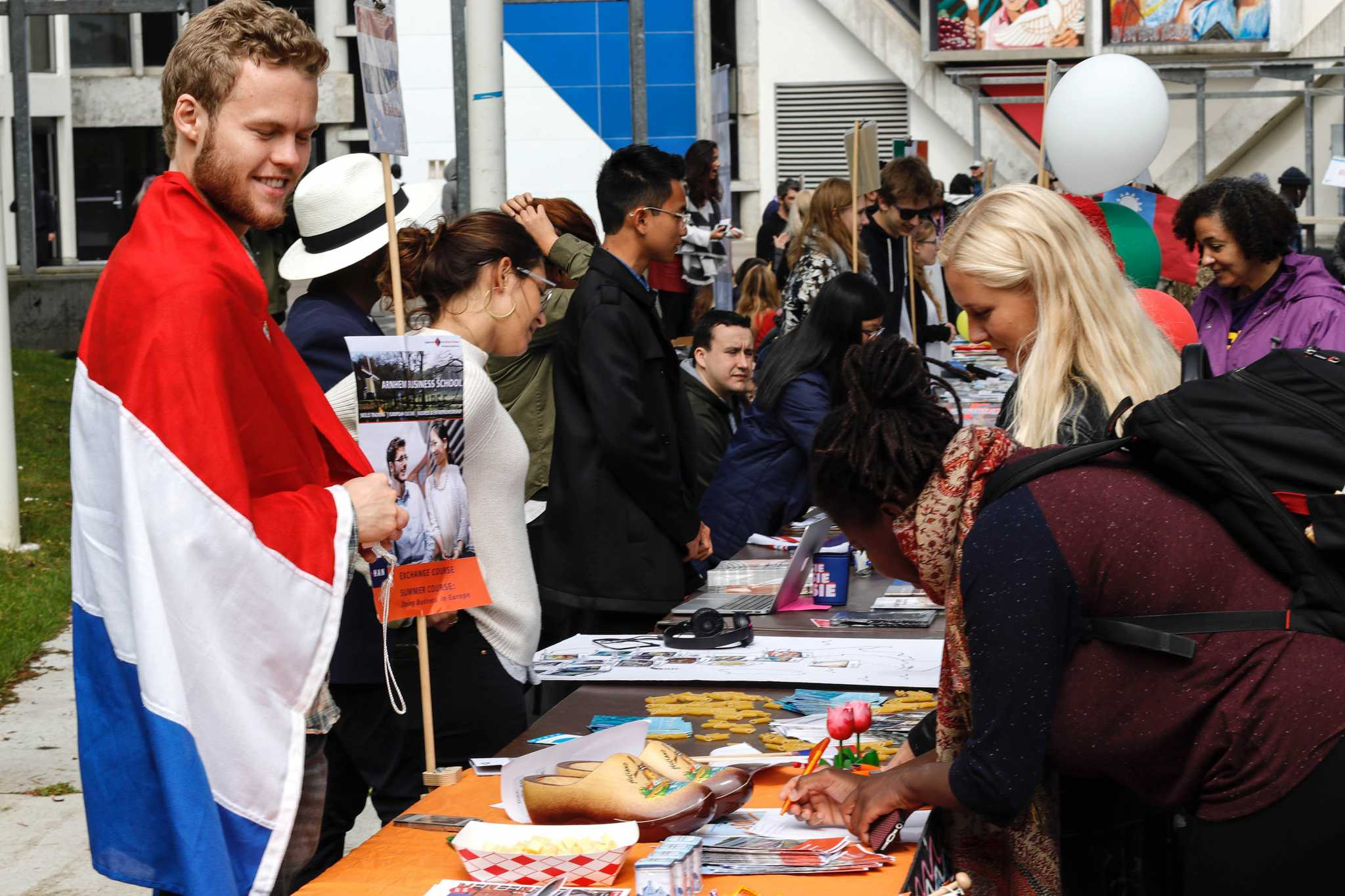 Exchange student and artificial intelligence major Sierk Kanis, 23, talks with two students about the Netherlands at the Study Abroad event held in the quad outside Cesar Chavez Center at SF State on April 12, 2017, in San Francisco, Calif. (Mason Rockfellow/Xpress)