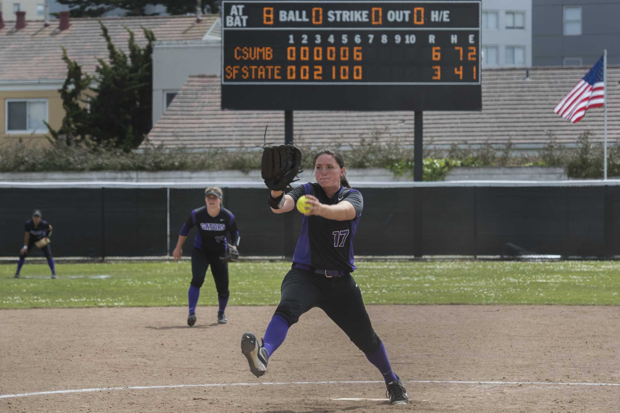 SF State Gators' senior left-hand pitcher Megan Clark (17) pitches against Cal State Monterey Bay Otters in the 7th inning after the Otters scored 6 points in the 6th inner at the Softball Park of SF State campus on Saturday, April 15, 2017. The Gators lose to the Otters 3-6. (Kin Lee/ Xpress)