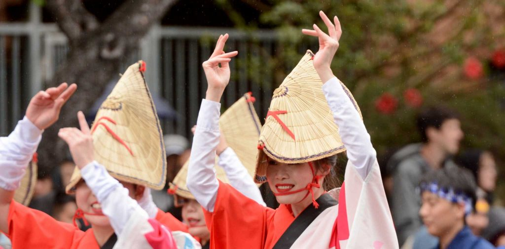 Two women, dressed in traditional Japanese garb, perform during the Grand Parade of the Cherry Blossom Festival in Japantown in San Francisco on Sunday, Apr 16, 2017. (Aaron Levy-Wolins/Xpress)