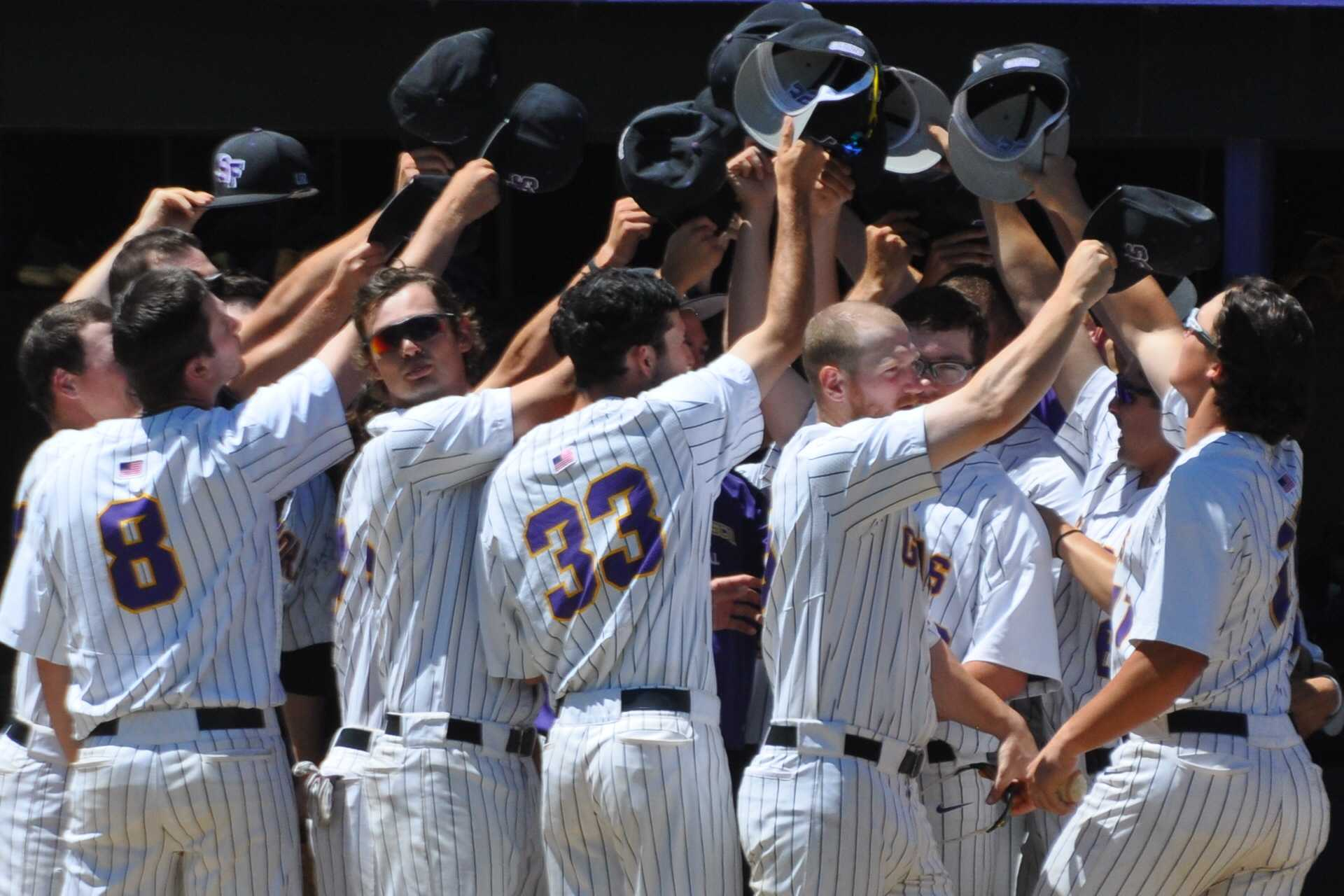 SF State Gators celebrate a 3-run RBI in the dugout against CSU Dominguez Hills on April 29 (Renee Smith/ Xpress)
