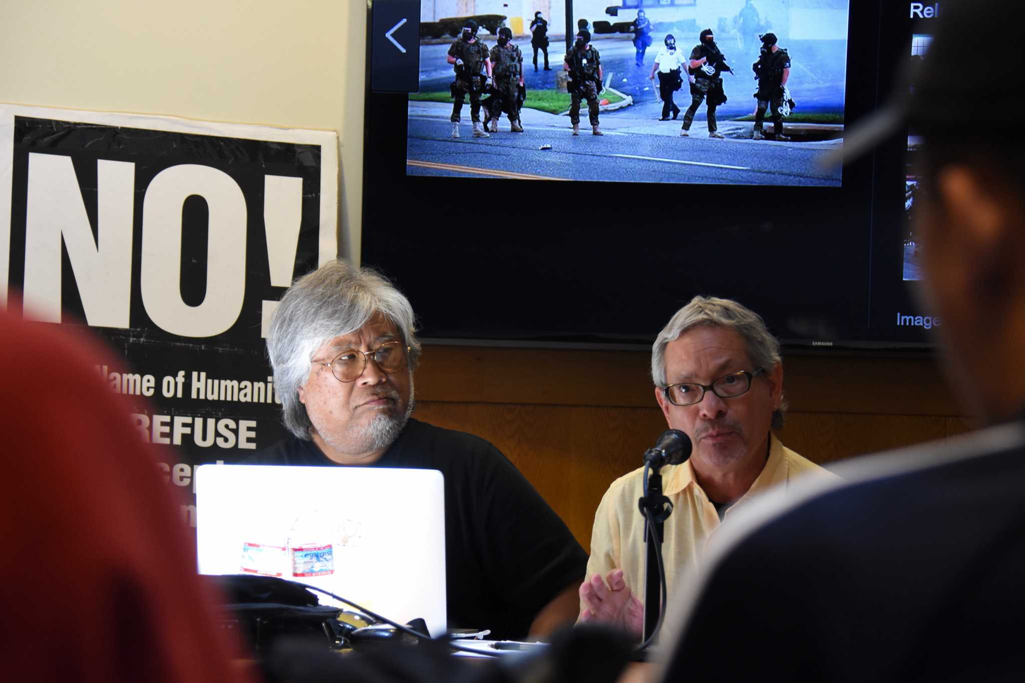 Daniel Phil Gonzales (L), professor of Asian American studies, and James Quesada (R), professor and department chair of anthropology, speak against fascism at the NO! Refuse Fascism teach-in at SF State on Tuesday, April 25, 2017. (Tate Drucker/Xpress)