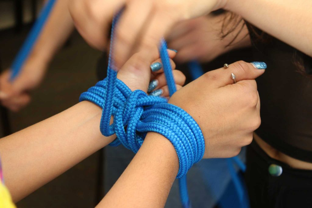 Students gather for a rope tying and bondage class held by the Kink Club on SF State Campus in the Cesar Chavez building on April 13, 2017. (Laila Rashada/ Xpress)