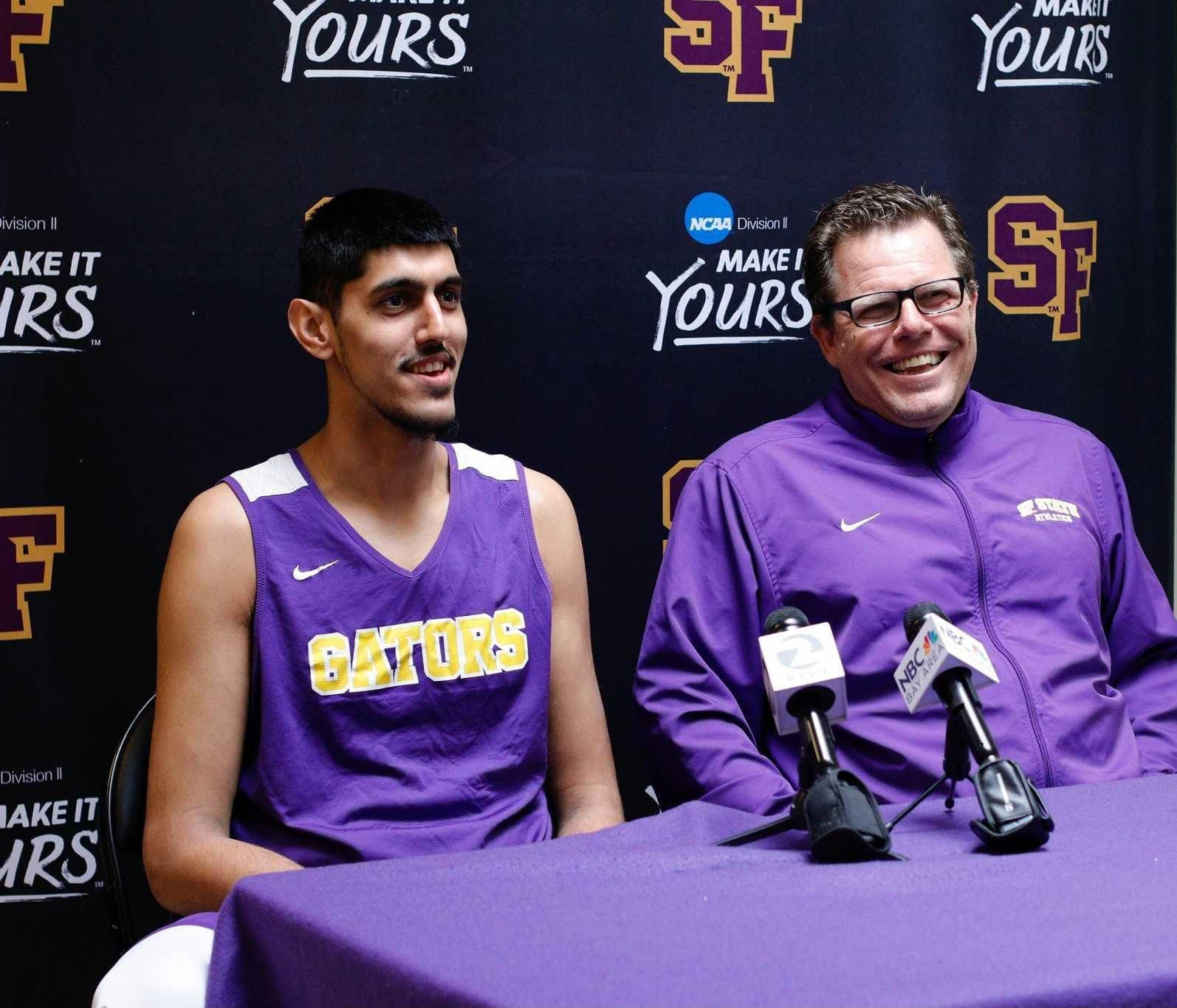 (L-R) Aj Kahlon (24) and Head Coach Paul Trevor talk to ABC, NBC, and KTVU during a press conference in the hallway of The Swamp at SF State on March 2, 2017 in San Francisco, Calif. (Mason Rockfellow/ Xpress)