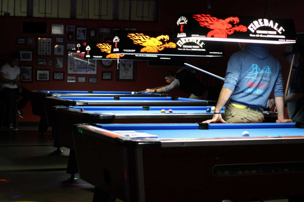 A group of men play pool a The Lister Bar in Parkmerced on April 26, 2017 in San Francisco, Calif. (Alina Castillo/Xpress)