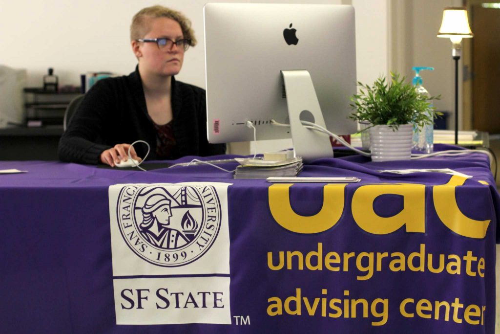 Graduation specialist, Revae Hitt, works in the Administration building at SF State on Tuesday, May 11, 2017. (Alina Castillo/Xpress)