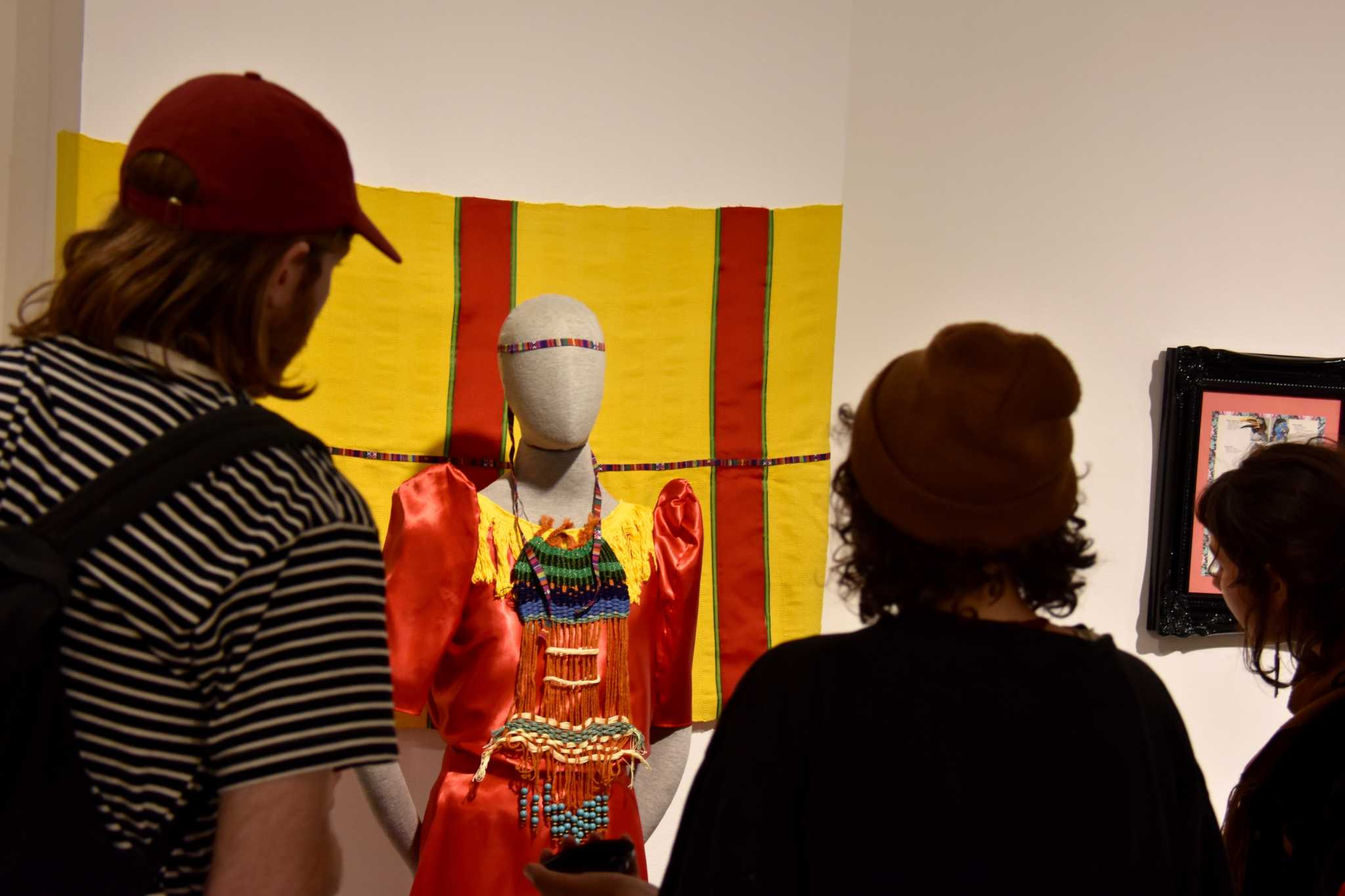 Students look at the art displayed at the ASI Art Gallery at SF State on April 27, 2017. (Tate Drucker/Xpress)