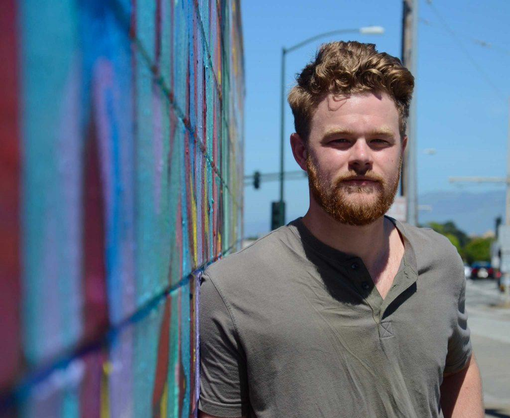 BECA student Shane Murphy stands on the corner of Randolph Street and 19th Avenue, where he filmed his interactive movie,