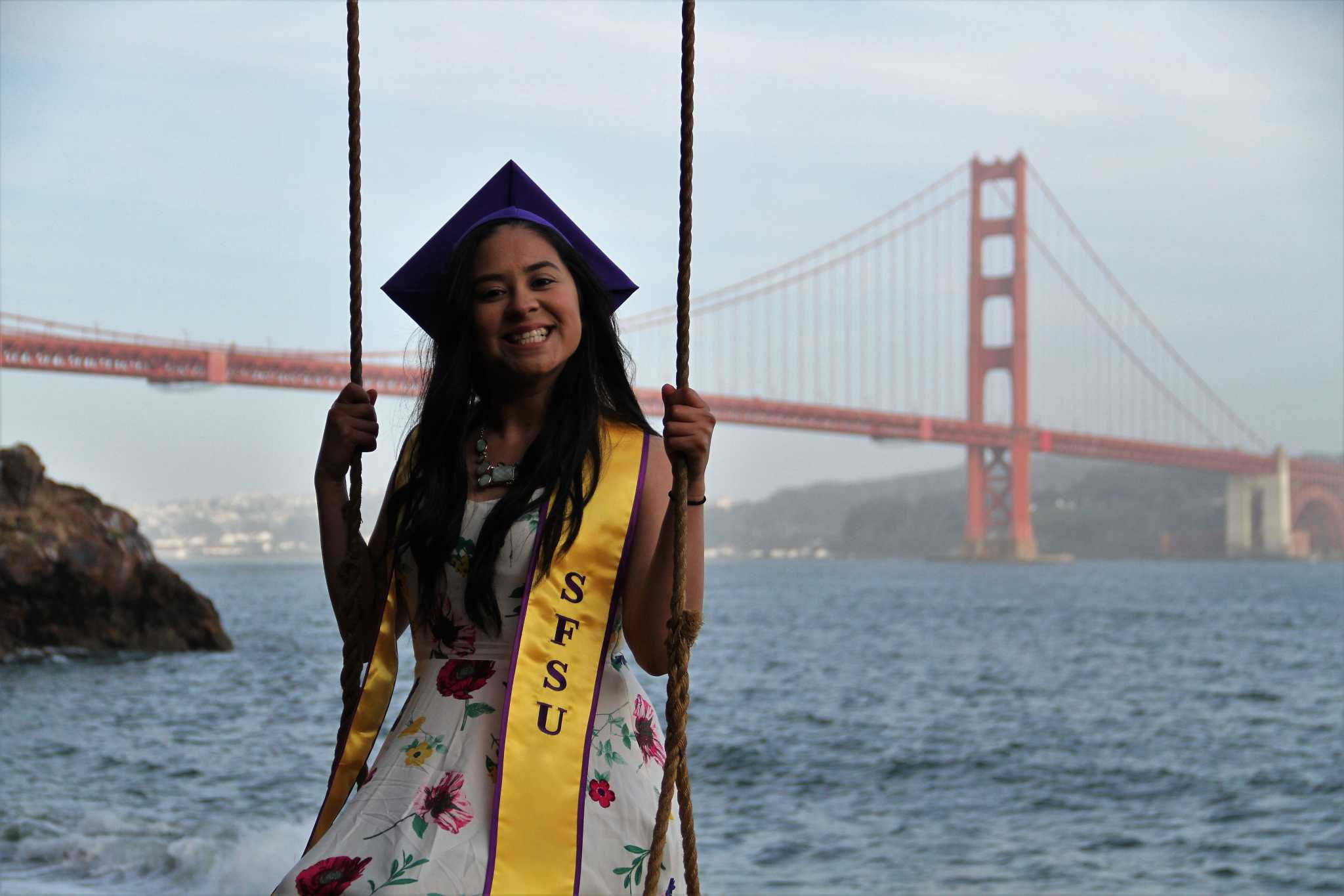 Annie Gonzalez poses for her graduation photos in front of the Golden Gate Bridge (Courtesy of Raul Guerrero)