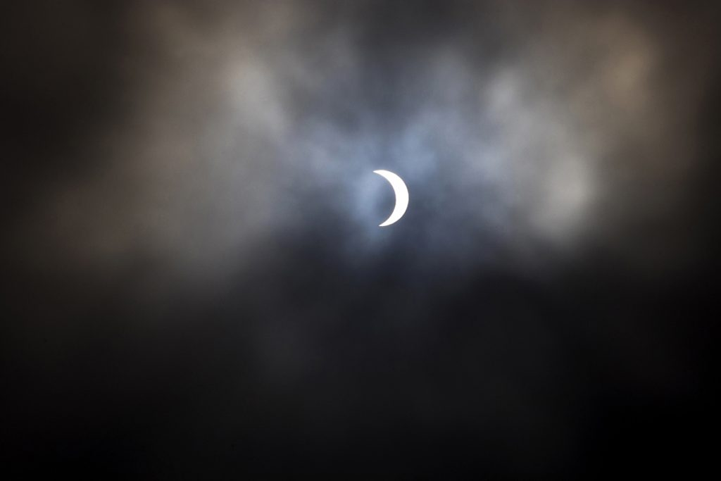 The Moon reaches maximum coverage of the Sun during a Monday morning solar eclipse on August 21, 2017. (Golden Gate Xpress/Mason Rockfellow)