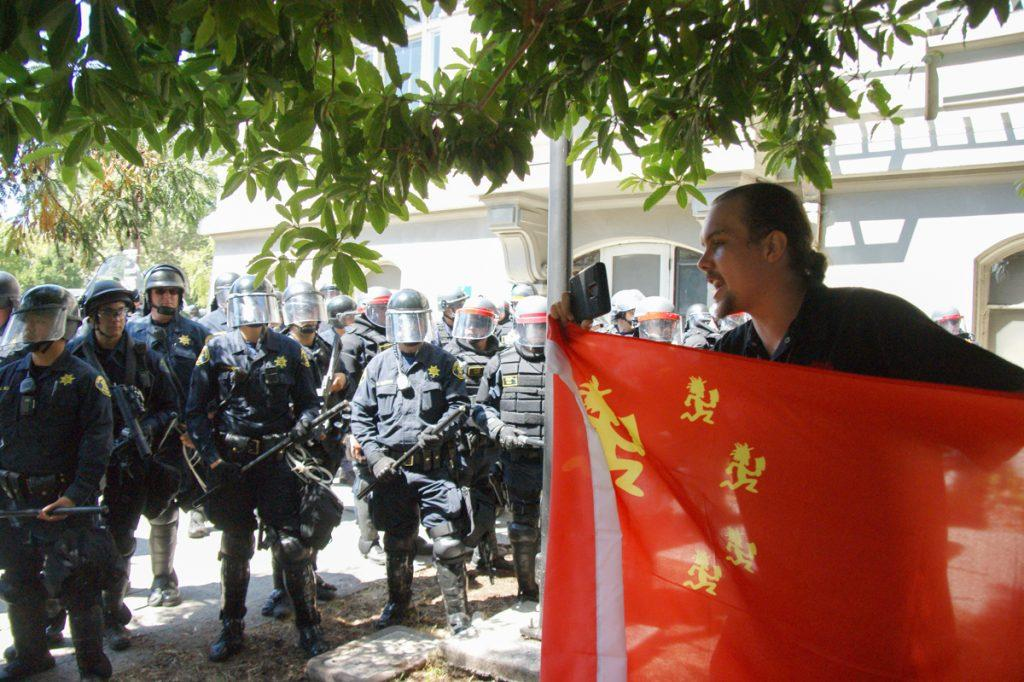 "A man films conflict between police and protesters during the ""No Marxism in America"" rally in Berkeley, Calif. on Sunday, August 27, 2017. (Aya Yoshida/Golden Gate Xpress)"