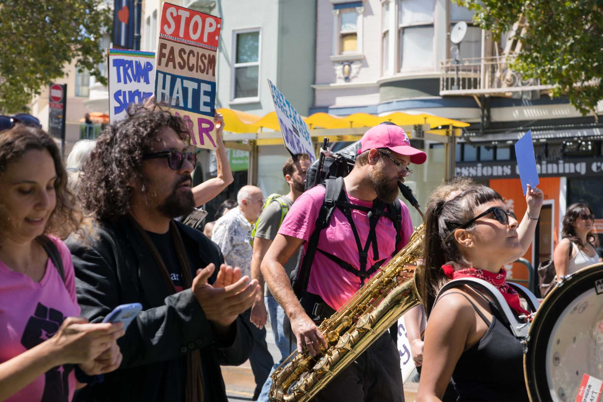 People play instruments during a counter-protest following the cancellation of a right-wing rally called