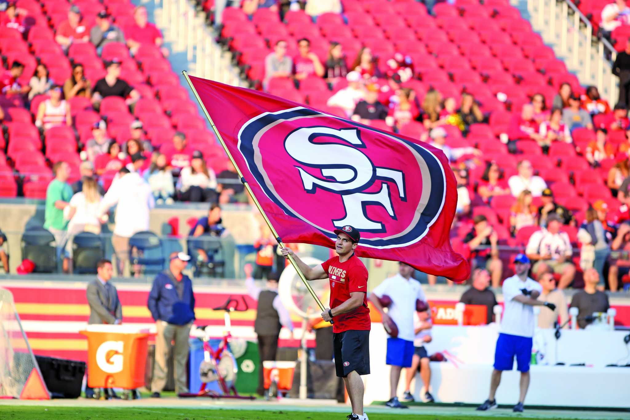 A man waves a flag before the San Francisco 49ers preseason game against the Denver Broncos at Levi's Stadium in Santa Clara, Calif. on Saturday, Aug. 19, 2017. (Mira Laing/Golden Gate Xpress)