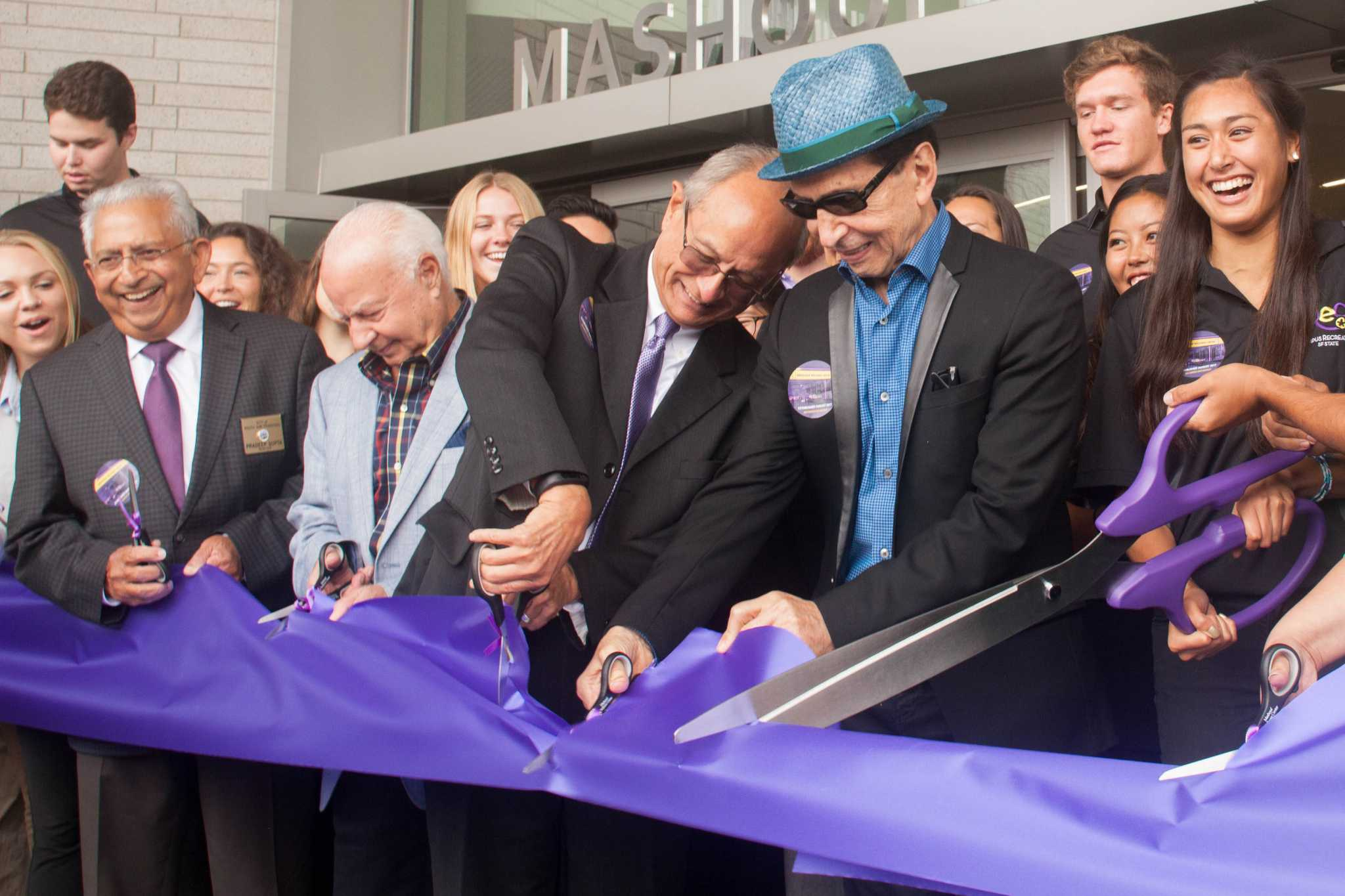 SF State President, Leslie E. Wong and Manny Mashouf cut a ribbon during the Mashouf Wellness Center Grand Opening on Tuesday, August 29, 2017. (Mitchell Mylius/Golden Gate Xpress)