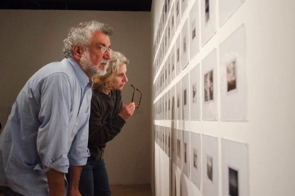 People view artwork during the opening reception of Recollected: Photography and the Archive at SF State, Sunday, September 23, 2017. (Richard Lomibao/Golden Gate Xpress)