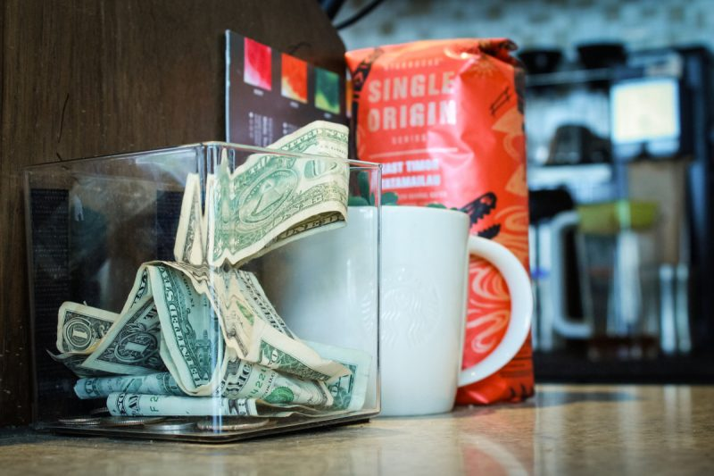 A tip jar is left on the counter at a Starbucks coffee shop on Monday, September 4, 2017. (Kayleen Fonte/Golden Gate Xpress)