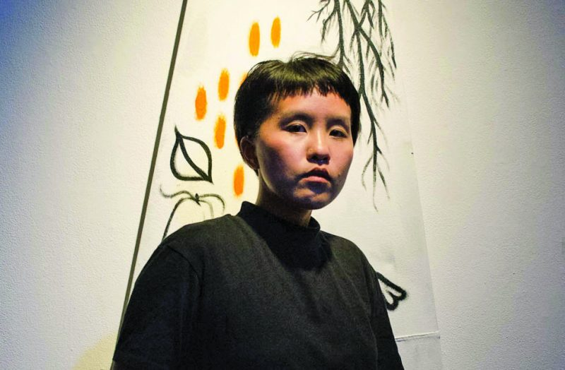 """Renae Moua poses for portrait in her last art installation entitled """"Queer Virality"""" in the ASI Gallery on Friday, Sept. 8, 2017. (Richard Lomibao/Golden Gate Xpress)"""
