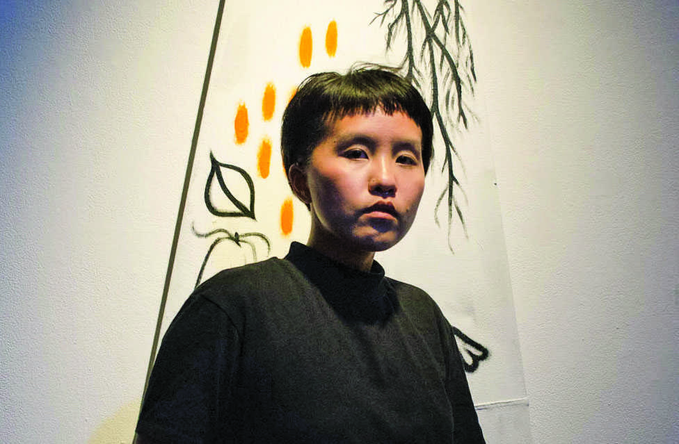 Renae Moua poses for portrait in her last art installation entitled