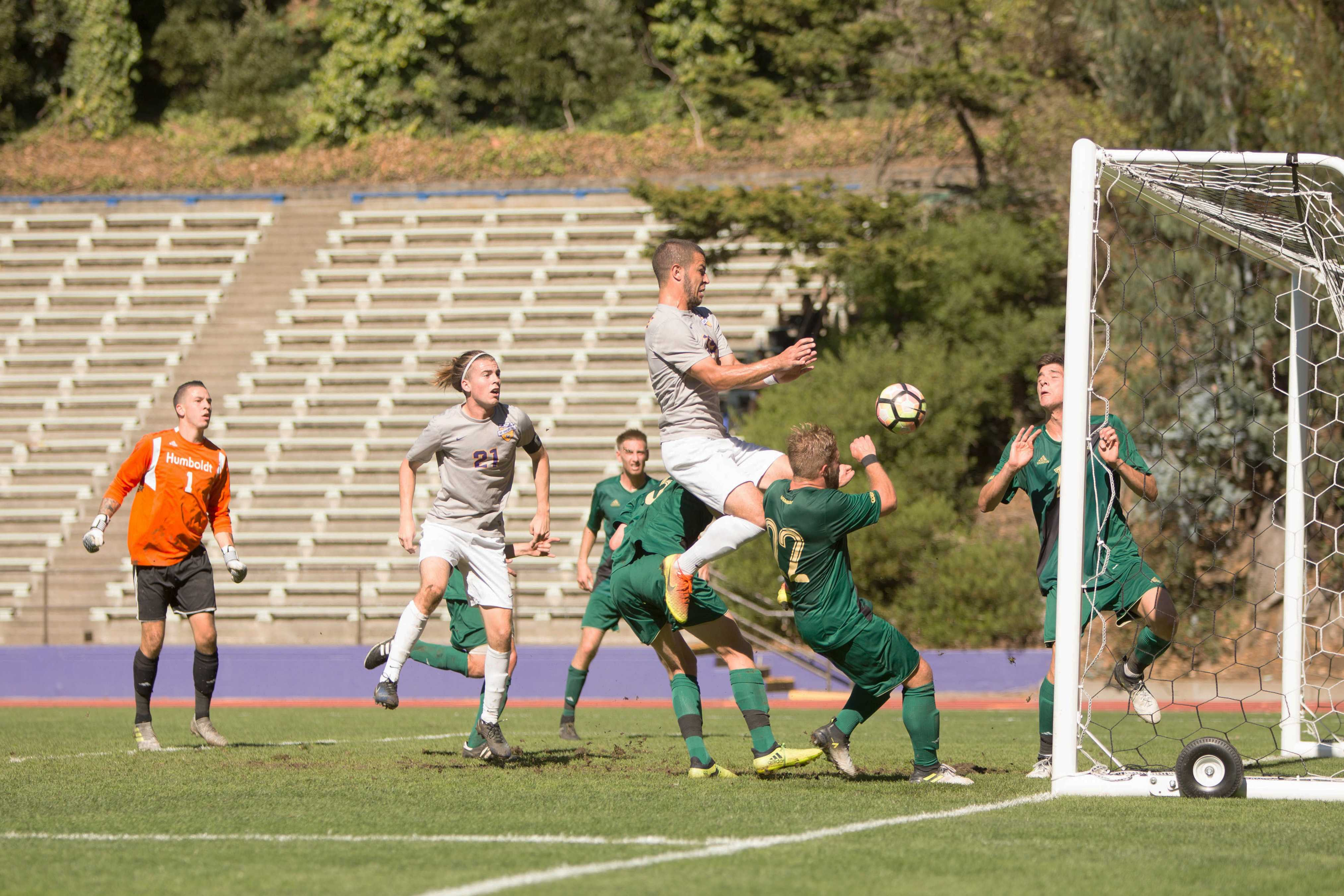 Tariq Pulskamp (#19) heads the ball into the goal against Humboldt State at Cox Stadium in San Francisco on Wednesday, October 25, 2017. Pulskamp scored his 5th goal of the season. (Mitchell Mylius/Golden Gate Xpress)