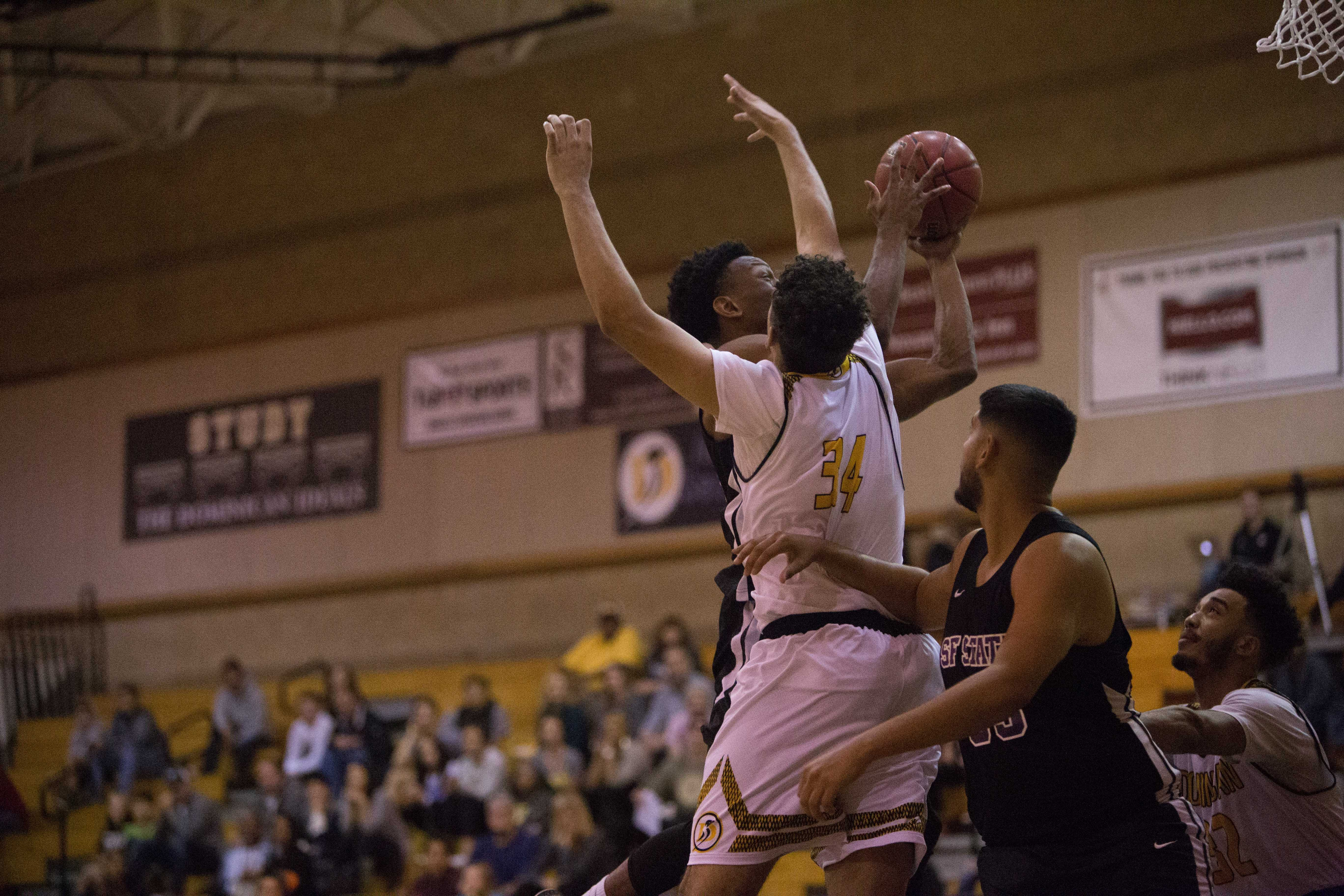 Chiefy Ugbaja (#23) slides past a UC Dominican defender for a lay up in San Rafael, Nov. 11, 2017. Ugbaja finished with 21 points and 7 rebounds. (Mitchell Mylius / Golden Gate Xpress)