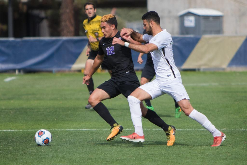 Feliciano+Cardenas+%28%2312%29+dribbles+the+ball+against+Cal+Poly+Pomona+at+UC+San+Diego+on+Nov.+3%2C+2017.+%28SF+State+Athletics%2FBrandon+Davis%29