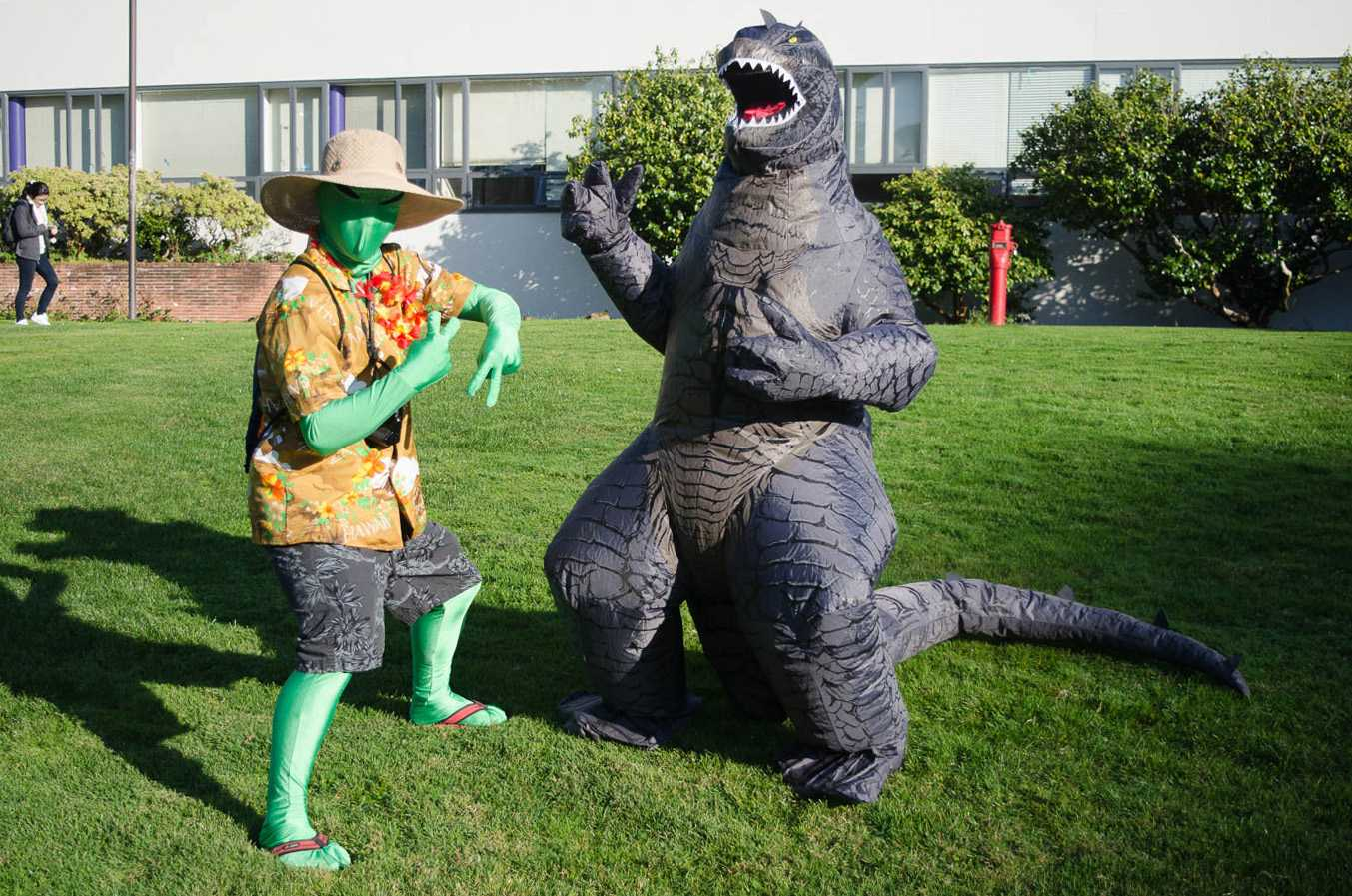 Michael Pham, 19, a biology major, is dresses as an alien tourist and Mason Hawksley, 19, a communications major, dresses as godzilla at SF State on Tuesday, October 31, 2017. (Richard Lomibao/Golden Gate Xpress)