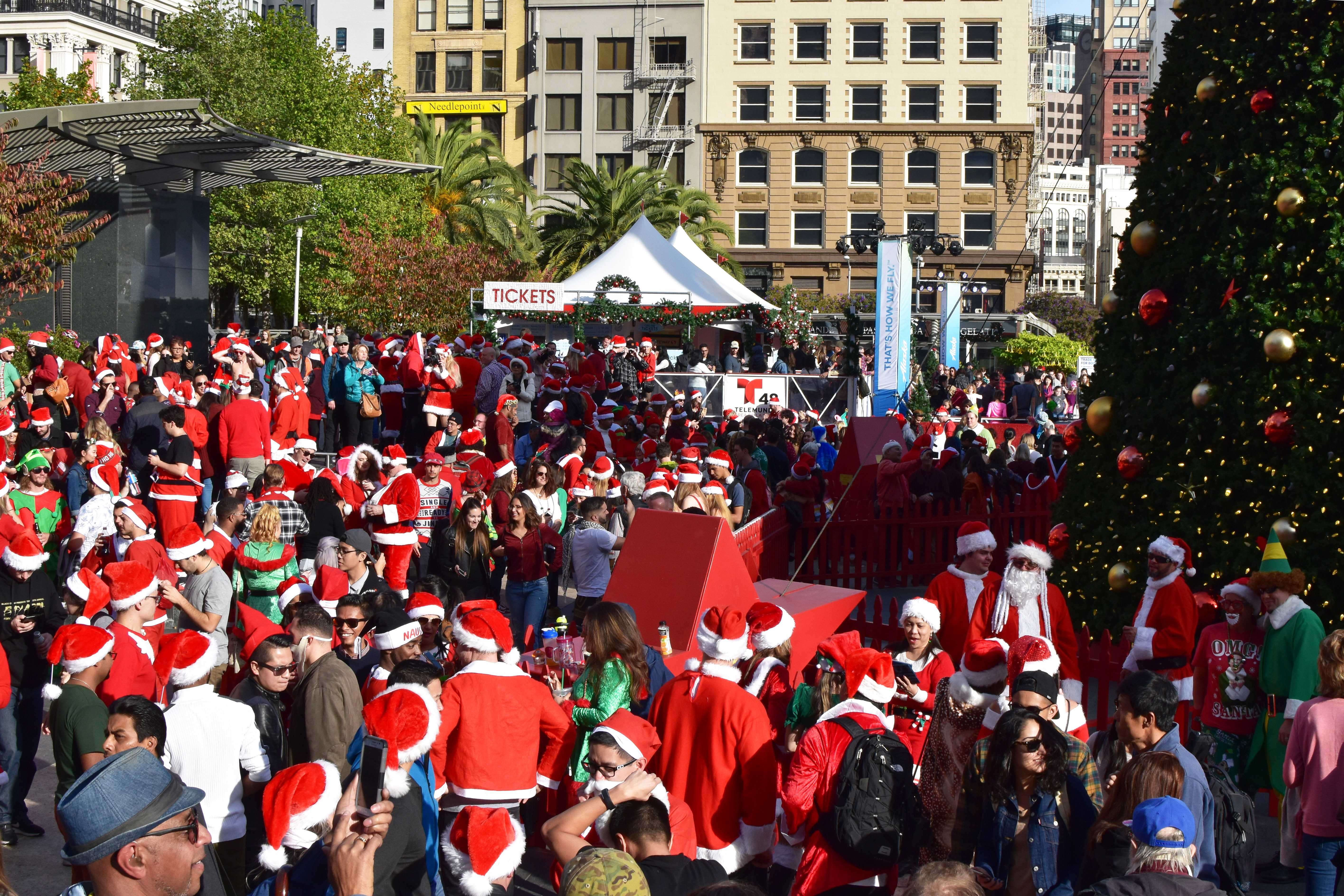 At least 200 hundred people dressed as Santa Claus gather for SantaCon 2017 at Union Square in San Francisco, Saturday, Dec. 9, 2017. (Garrett Bergthold/Golden Gate Xpress)
