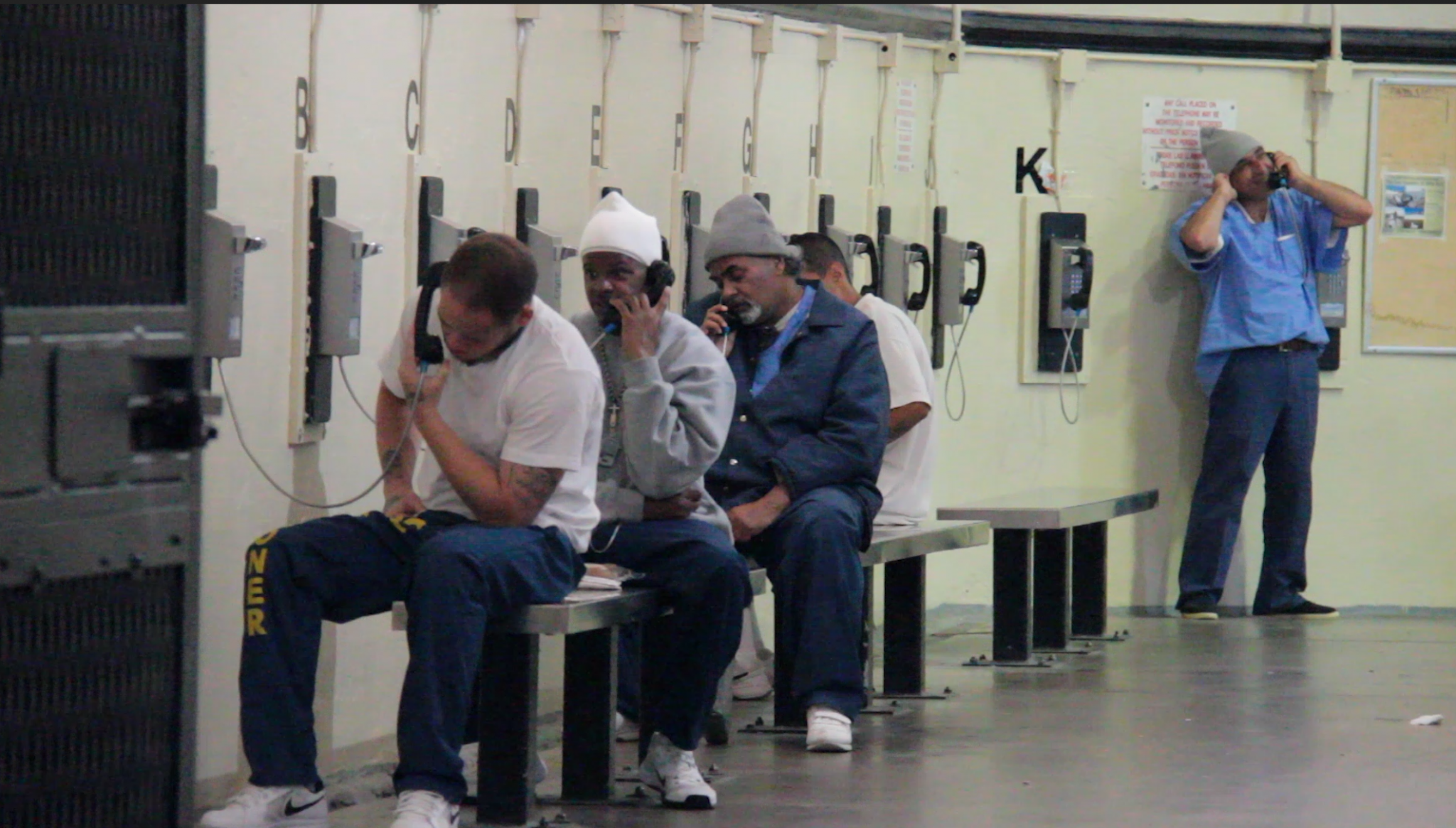 Inmates at San Quentin State Prison use the phones in West Block, a housing unit with five tiers of cells, October 10, 2016.