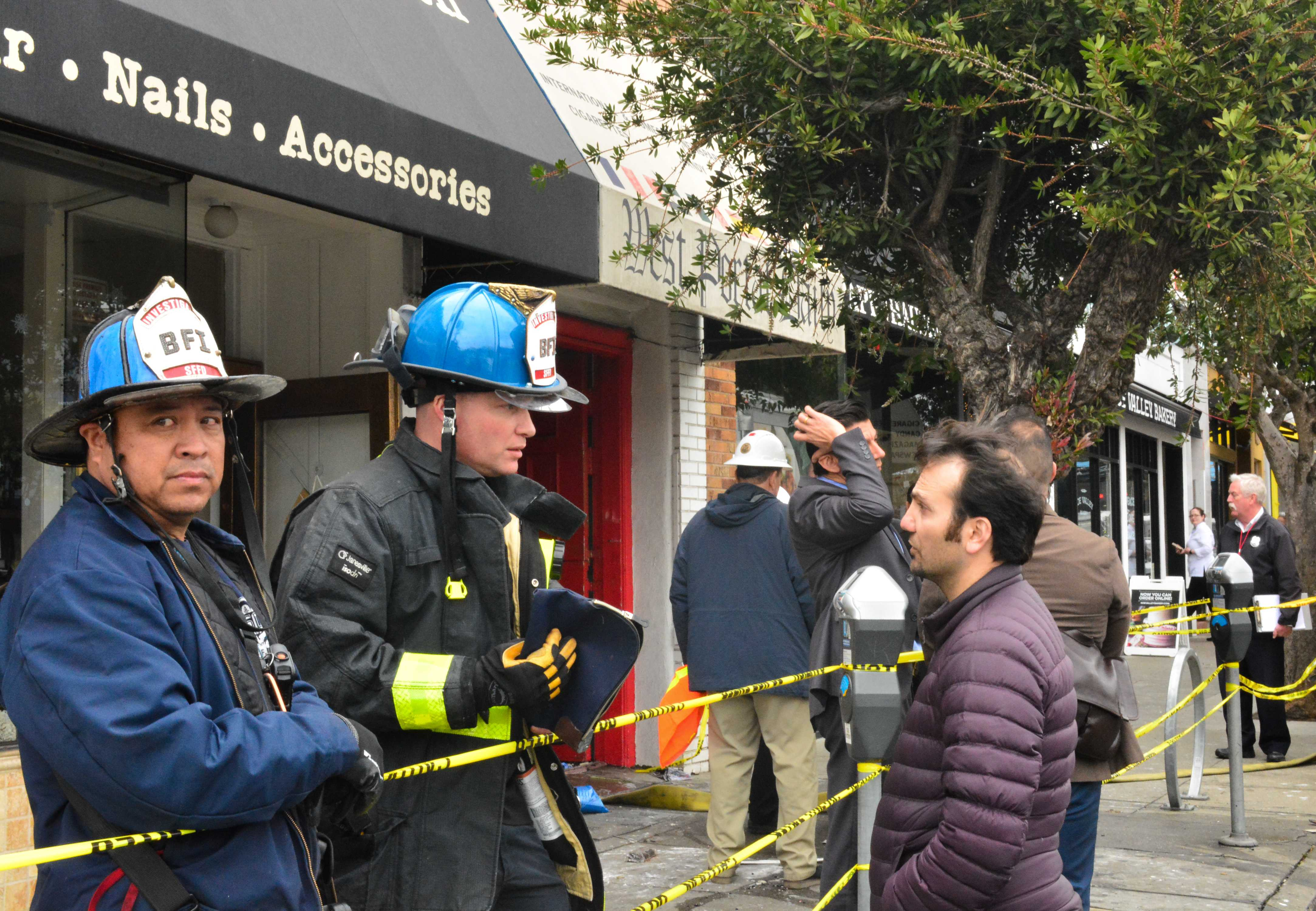 Business owner of the West Portal Daily speaking to SFFD about the damages that occurred to his business on Wednesday, January 24th, 2018 in San Francisco.    Bryan Ramirez/GoldeGateXpress