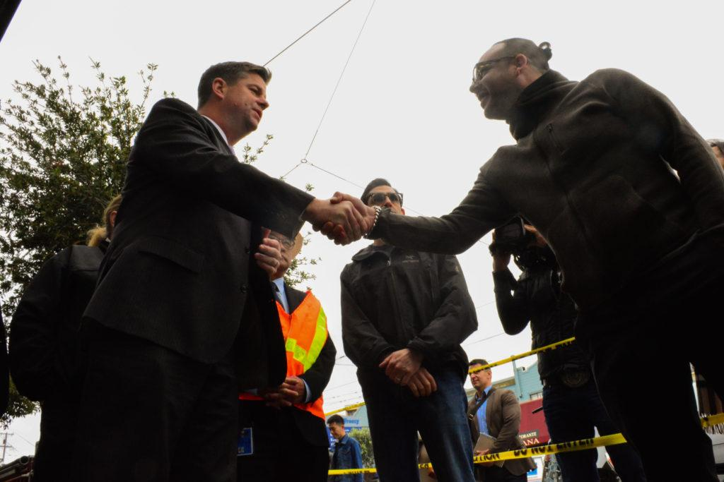 New appointed San Francisco Mayor Mark Farrell shakes hands with Michael Gonzales, husband of the owner of Sloane Square Salon, after the fires destroyed their business in San Francisco's West Portal District on Wednesday, Jan. 24, 2018. (Bryan Ramirez/Golden Gate Xpress)       Bryan Ramirez/GoldeGateXpress