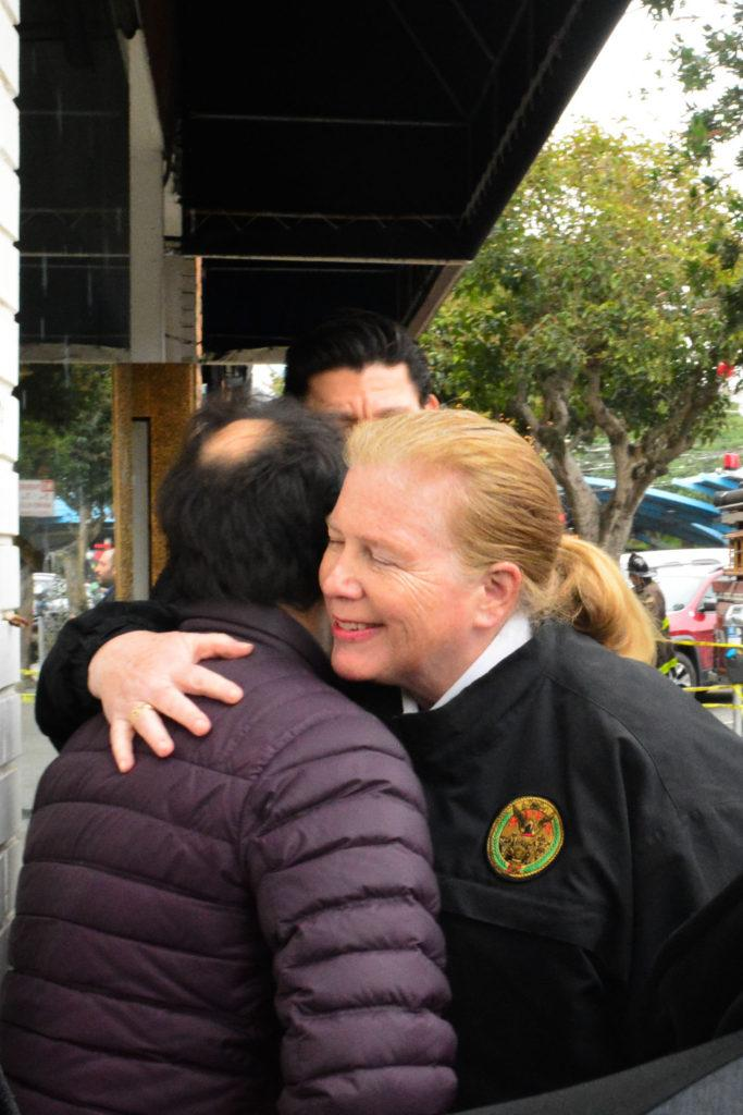 San Francisco Fire Department Chief, Joanne Hayes-White hugs a business owner of the West Portal Daily as his business was affected by the fire on Wednesday, Jan. 24, 2018. (Bryan Ramirez/Golden Gate Xpress)