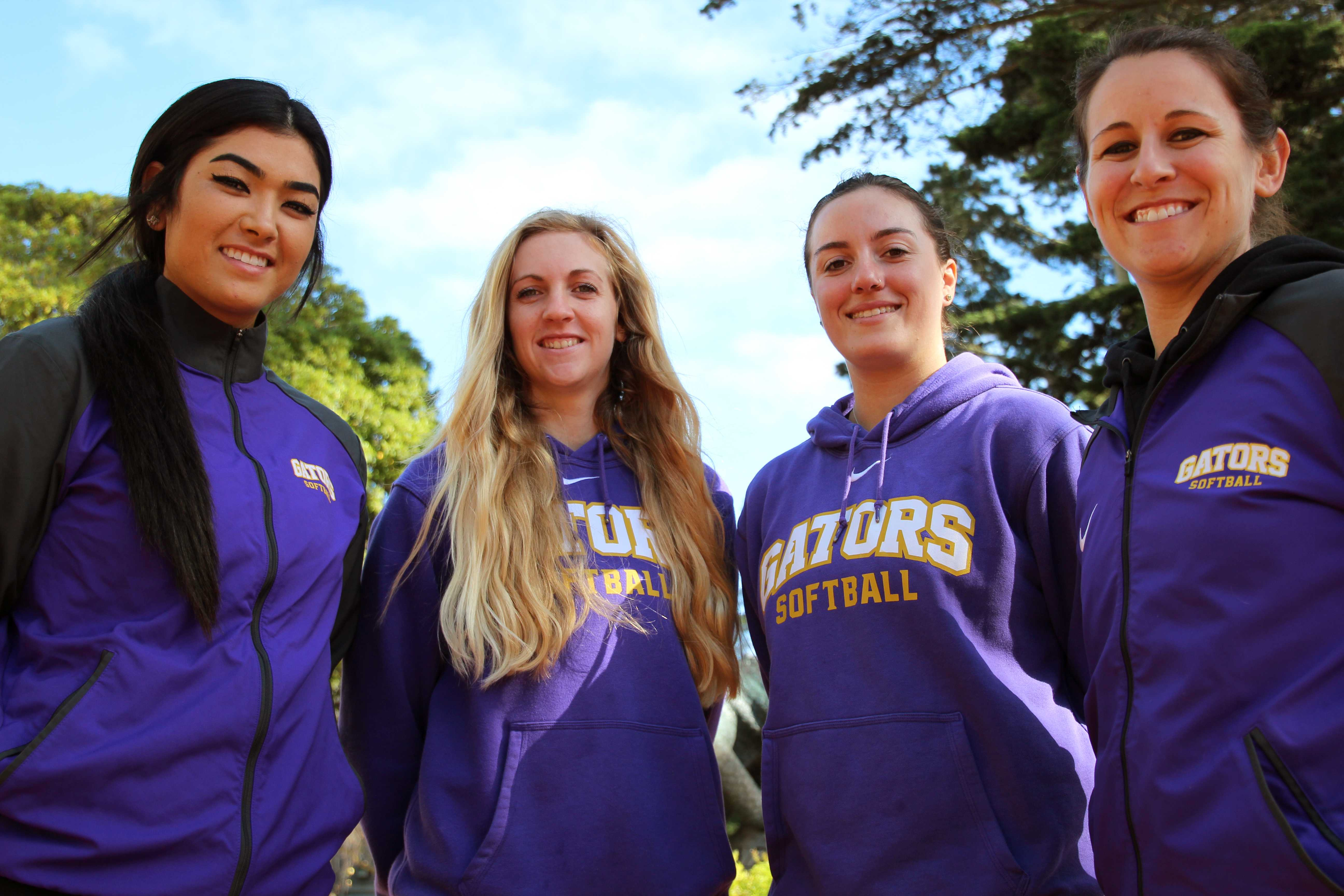 SFSU Softball third baseman Sara Higa (left), pitcher Lindsey Cassidy, outfielder Mallory Cleveland and coach Alicia Reid pose for a portrait outside the Gymnasium at SF State, Monday, Jan. 22, 2018.  Reid was previously head softball coach at Humboldt State University for 5 years before starting this past year at SFSU and said,