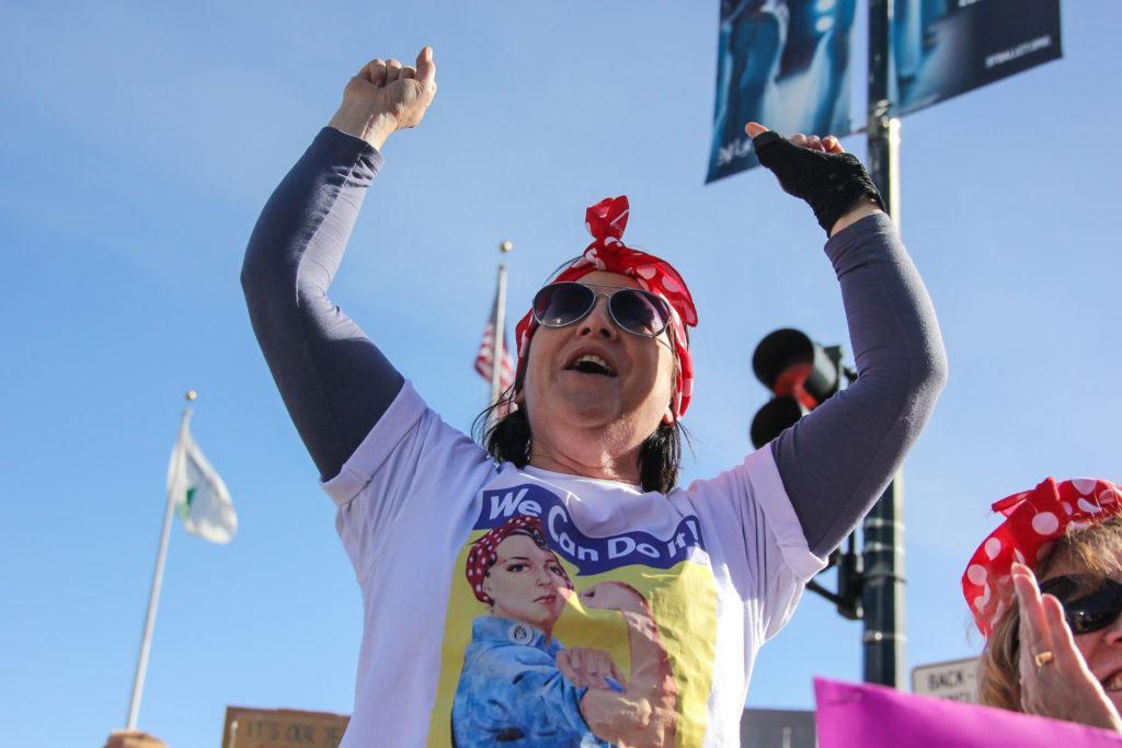 Brenda Haas, 59, raises both her hands as she cheers on a speaker outside of Civic Center Plaza during the Women's March in San Francisco, Saturday, Jan. 20, 2018. (Golden Gate Xpress/ Adelyna Tirado)