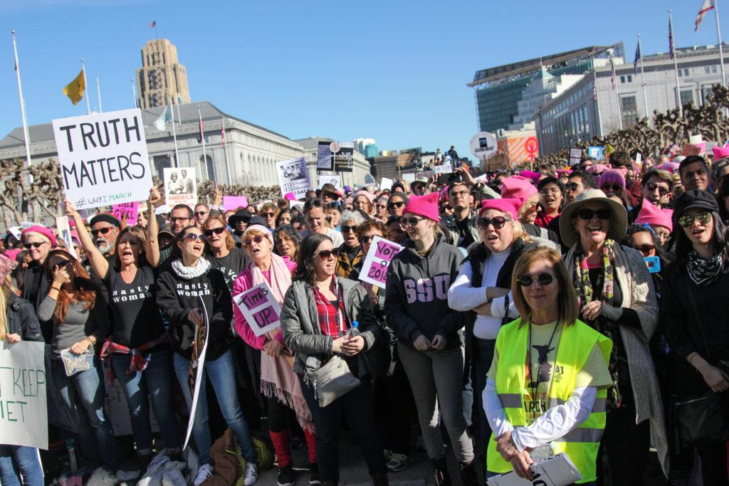 A crowd gathers together hearing the speaker during the San Francisco Women's March at Civic Center Plaza on Saturday, Jan. 20, 2018. (Golden Gate Xpress/ Adelyna Tirado)