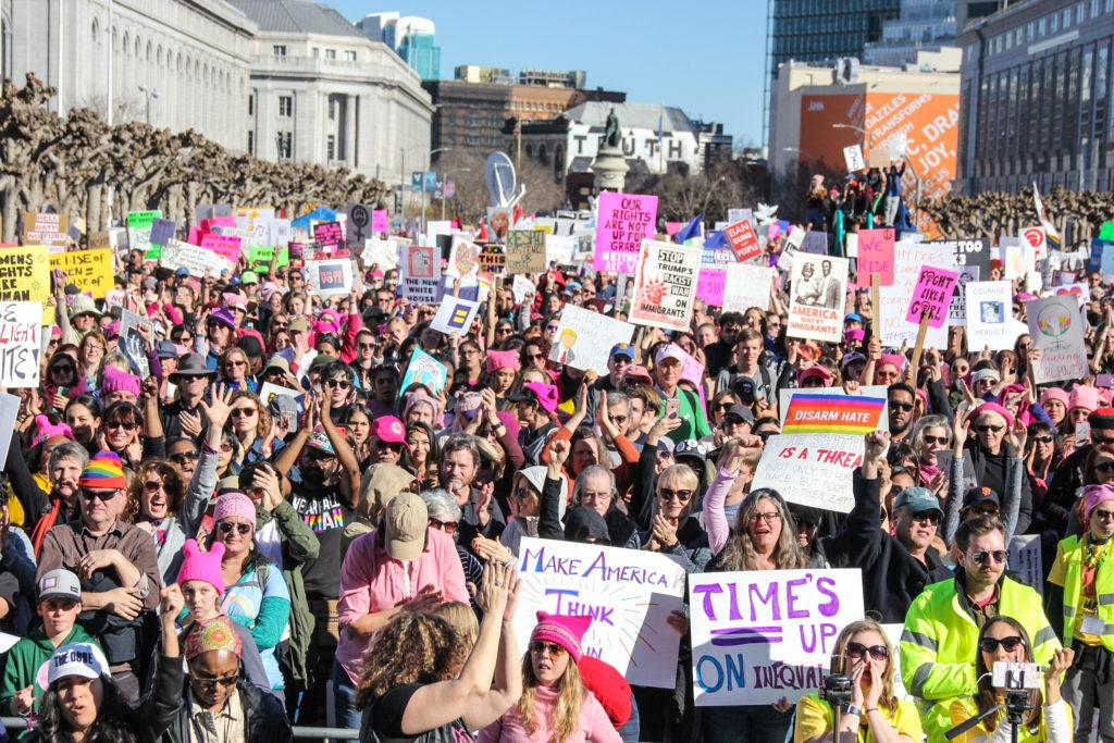 A sea of thosands of people gatheres together with hand-made signs outside of Civic Center Plaza during the Women's March in San Francisco, Saturday, on Jan. 20, 2018. (Golden Gate Xpress/ Adelyna Tirado)