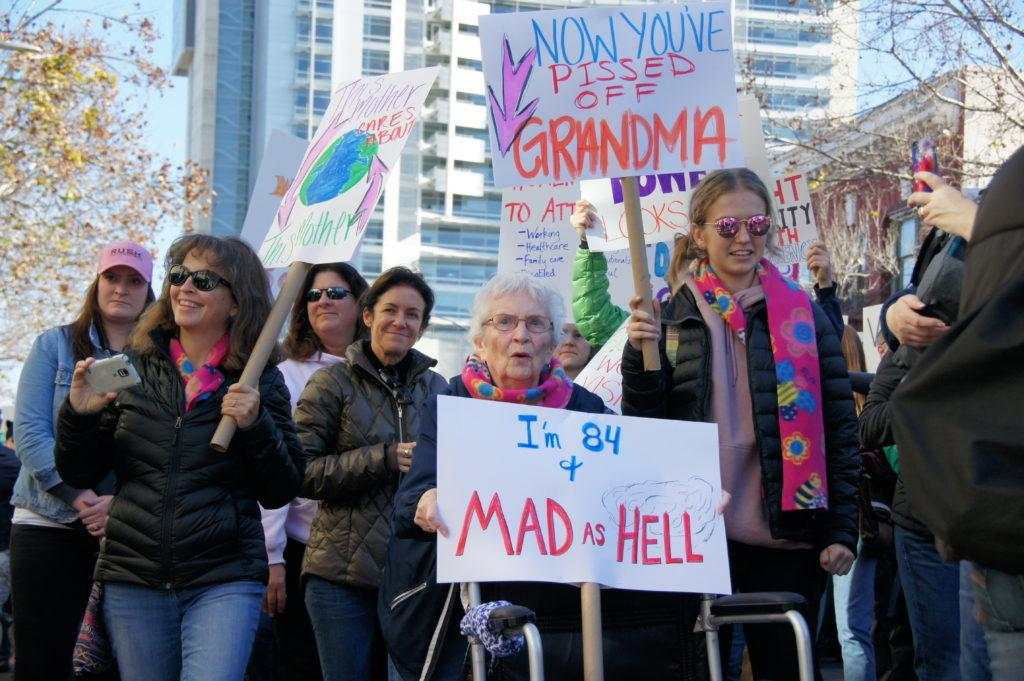 A 84-year-old woman marches with her family members during Women's March in San Jose, Saturday, Jan. 20, 2018. (Aya Yoshida / Golden Gate Xpress)