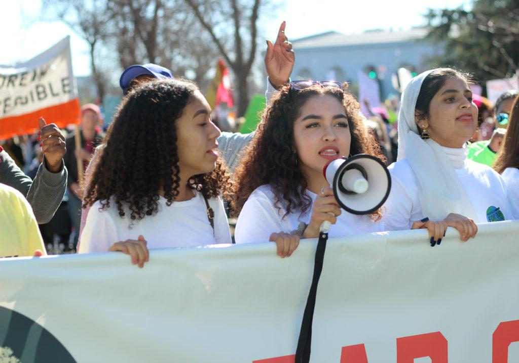 Laila Schmedel, (center), March for Our Future member and Las Positas College student speaks during the Women's March in Oakland, Calif., on Saturday, Jan. 20, 2018.March for Our Future is a youth-based group encouraging the youth to get involved politically and socially.(Golden Gate Xpress/ Christian Urrutia)