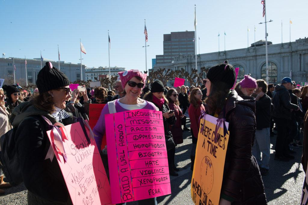 Participants of Women's March look over each other's signs in San Francisco, Saturday, Jan. 20, 2018. This year was the second year San Francisco hosted a Women's March. Last year's was started because of the inauguration of President Donald Trump and continues this year because of the empowerment and influence it brought to those that attended.(Golden Gate Xpress/ David Rodriguez)