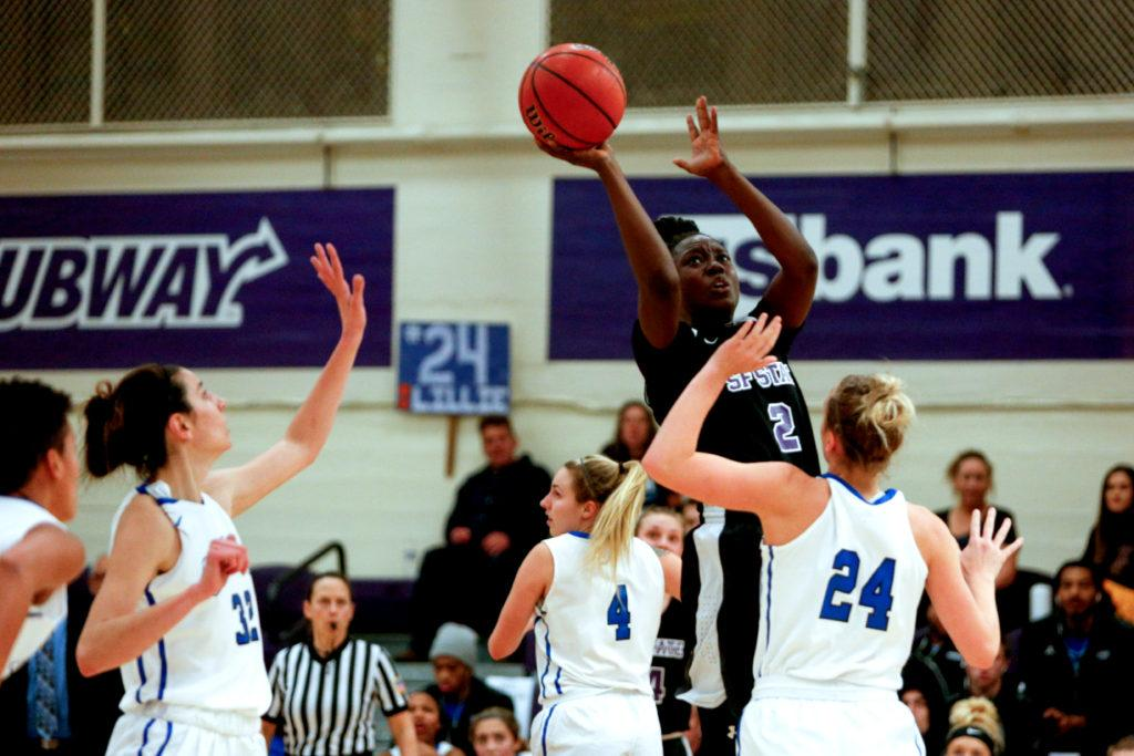 SF State's Jhaina Stephens (2) attempts a shot over a Cal State San Marcos defender during the first quarter of the basketball game on Spirit Night at SF State on Friday, Feb. 2, 2018. (Niko LaBarbera/Golden Gate Xpress)