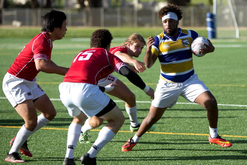 Tariq Nugud, right, runs the ball against Stanford at Gellert Field in Daly City on Saturday, Feb. 10, 2018. Stanford would go on to defeat SF State 44-24. (Travis Wesley/Golden Gate Xpress)