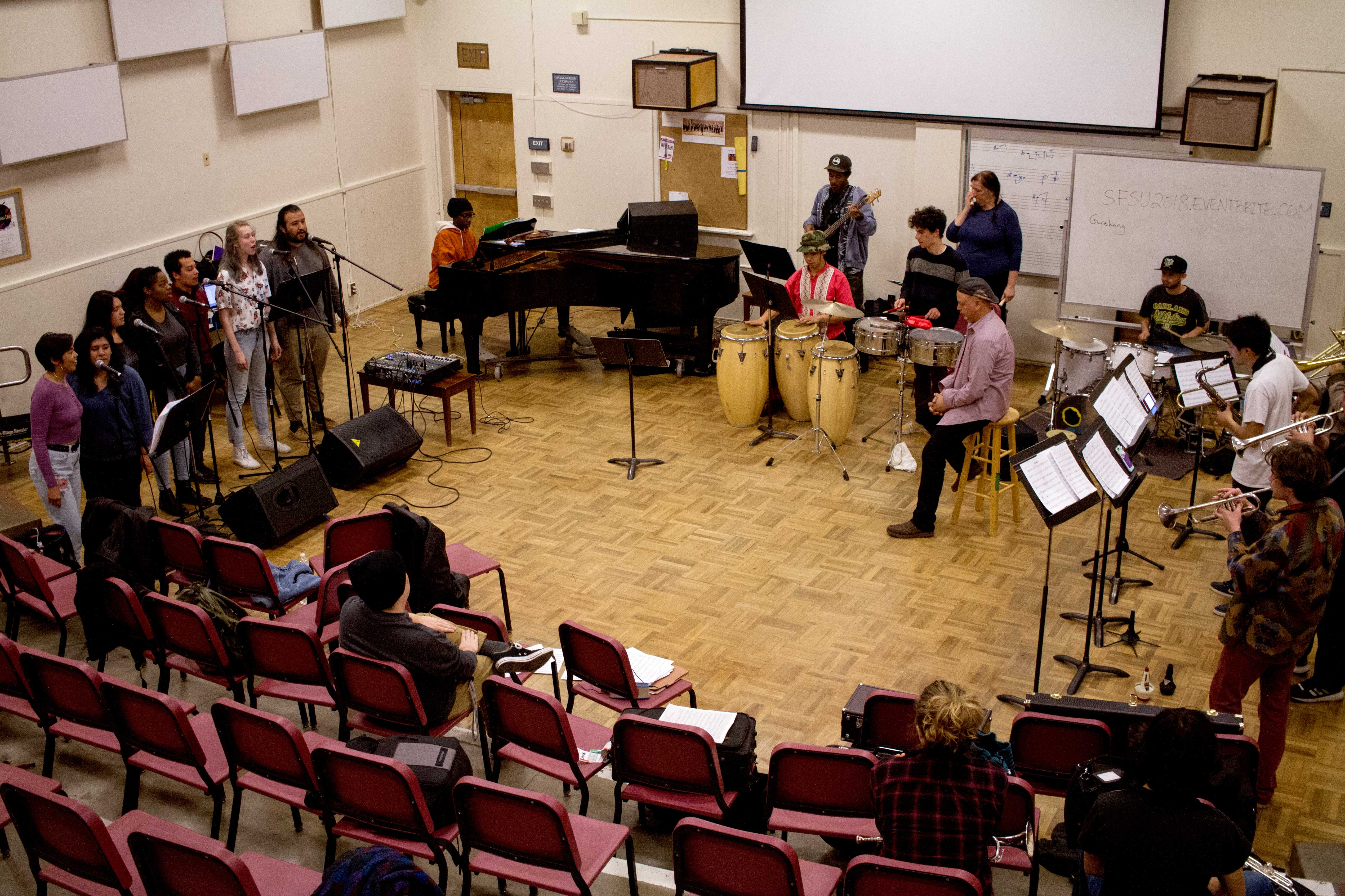 The SF State Afro-Cuban Ensemble works through a song together at their rehearsal at SF State on Wednesday, Feb. 21, 2018.