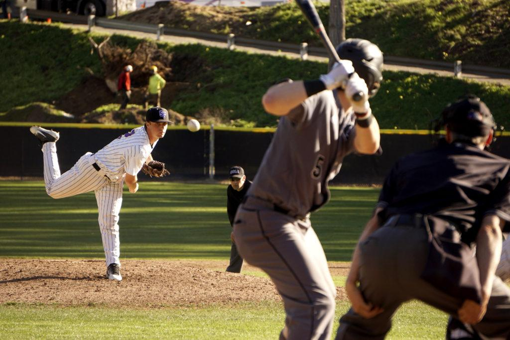 A freshman pitcher Tyler Franks (12) throws a strike against the Urban Knights at Maloney Field in San Francisco on Tuesday Feb. 13, 2018. (Diego Aguilar/Golden Gate Xpress)   (Diego Aguilar /Golden Gate Express)