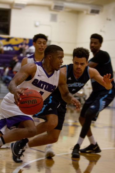 SF State's Warren Jackson (1) tries to get past Sonoma State's Brandon Tillis (2) to score during the game at SF State on Saturday, Feb. 10, 2018. (Joey Vangsness/Golden Gate Xpress)