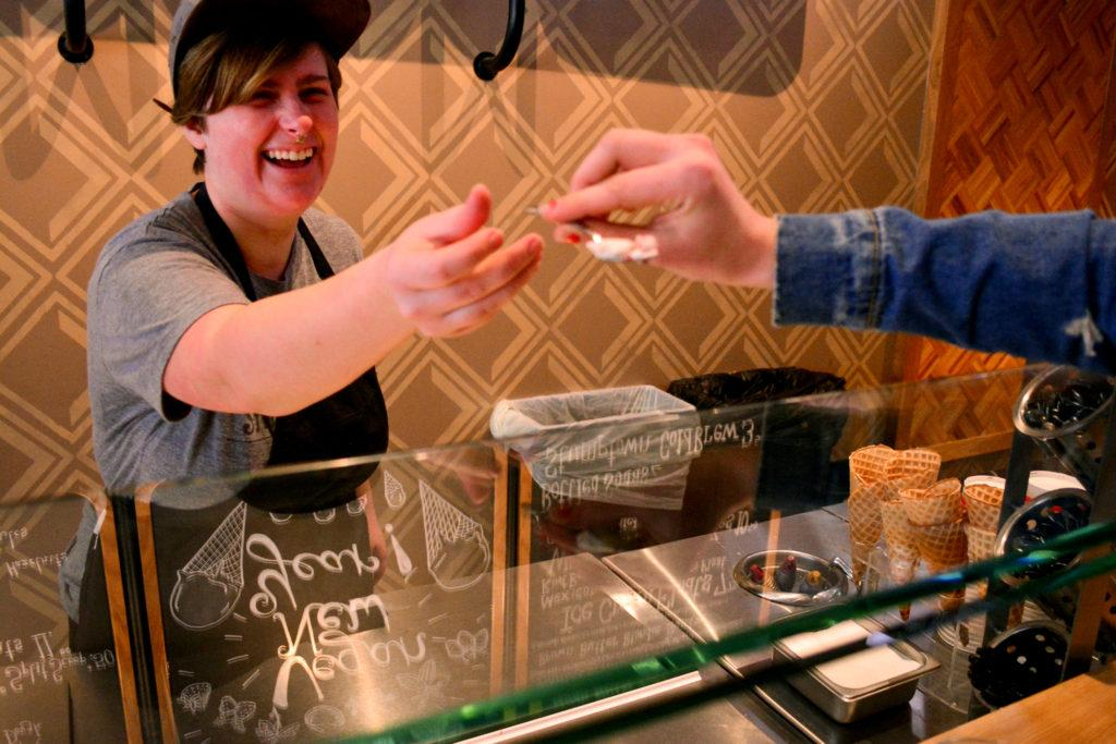 Skyla Stalcup, an ice cream creator at Salt and Straw in San Francisco, hands out a sample to a customer on Tuesday, Jan. 30, 2018. (Bryan Ramirez/Golden Gate Xpress)