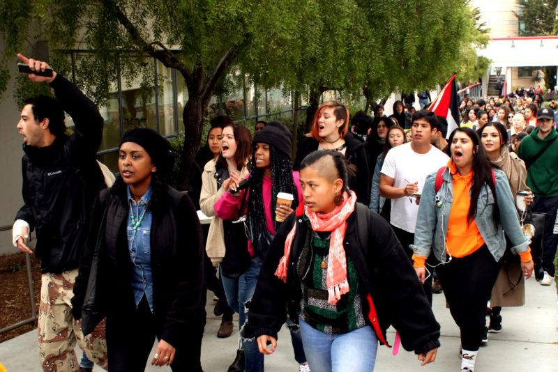Students walk through the San Francisco State Campus to protest about ICE raids occuring in the Bay Area in San Francisco, on Feb. 28, 2018. (Janett Perez/ Xpress)