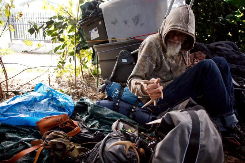Mike Rinebold begins to pack his belongings before leaving his camp site near Hippie Hill in Golden Gate Park on Saturday Nov. 11, 2017. (Niko LaBarbera/Golden Gate Xpress)