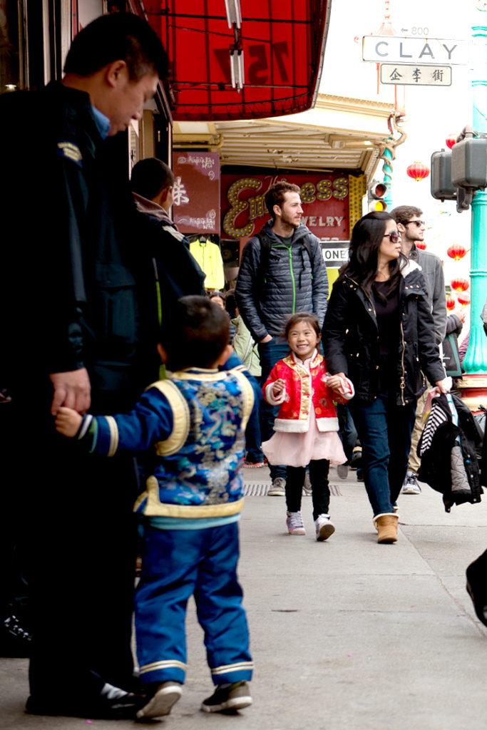 Jacob Luong, left, stands with his dad while the pair wait for the mother and daughter, Katelyn Luong, right in San Francisco's Chinatown on Saturday Feb. 24, 2018. The two children are dressed and ready for the Chinese Lunar New Year. (David Rodriguez/Golden Gate Xpress)