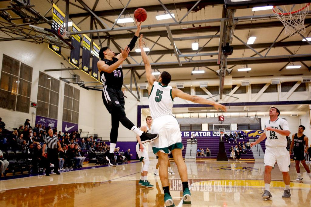 SF State's Brantley Bynum (21) takes a shot from outside the key during the regular season finale game against Humboldt State at SF State on Saturday, Feb. 24, 2018. The Gators won 72-60 on Senior Night and extended their regular season record to 18-10.(Niko LaBarbera/Golden Gate Xpress)