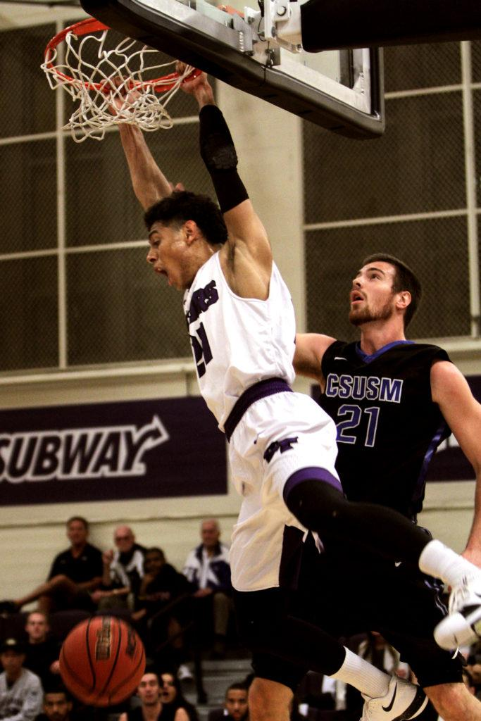 SF State's Brantley Bynum (21) dunks the ball to score in the first half of the game against Cal State San Marcos during Spirit Night at SF State on Friday, Feb. 2, 2018. Bynum scored 25 points during the game.(Joey Vangsness/Golden Gate Xpress)