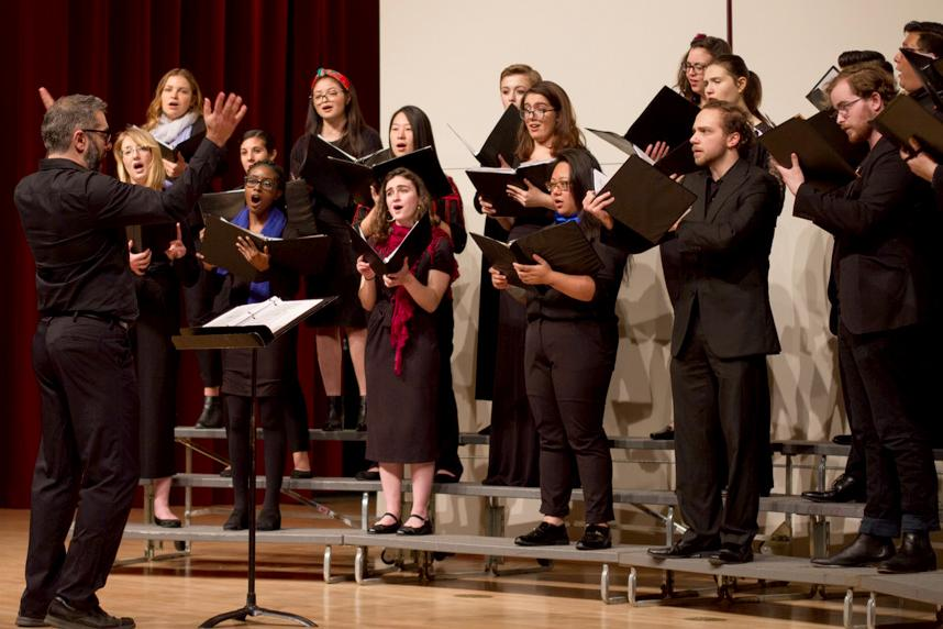 Nikolas Nackley, Director of the Chamber Singers at SF State, conducts the ensemble during the Black History Month Celebration Recital at SF State on Wednesday, Feb. 14, 2018. (Joey Vangsness/Golden Gate Xpress)
